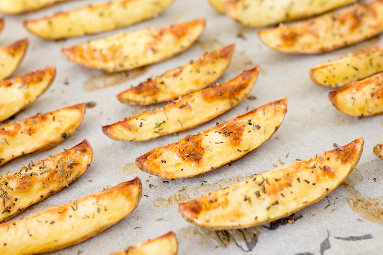 potato wedges on baking tray